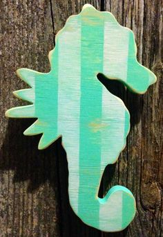 Teal and white striped distressed wood seahorse