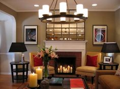 candles in the fireplace with fireside chairs. lean mirror on fireplace to cover TV when not in use