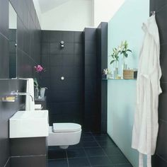 Create the perfect wet room. Frosted glass panel as wall.
