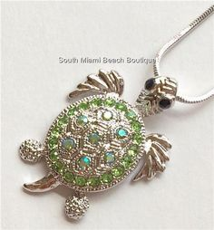 Silver Crystal Sea Turtle Necklace Pendant with sparkly green crystals 17 inch long chain included. Sea Turtle Jewelry, Turtle Necklace, Green Necklace, Pendant Necklace, Turtle Love, Nautical Jewelry, South Miami, South Beach, Miami Beach