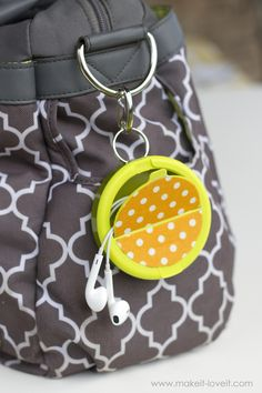 Make an EARPHONE HOLDER (...from a mint container). Add pops of texture to the top or leave it plain...a great way to keep those earphones tangle free!