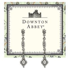 High shine style from our Downton Abbey® Stardust Collection. Lovely linear drop earrings are crafted from sleek polished silver and opulently enhanced with sparkling white diamond jewels and creamy white pearls. Presented on a Downton Abbey-themed card.