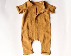 This beautiful, mustard, washed linen romper is the perfect addition to any little ones wardrobe. It is soft and breezy and perfect for all year round. The fabric really is just so soft lovely for the little ones skin and 100% natural. The rompers are harem style with ankle length leg,