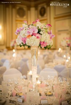 Tall elegant centerpiece | Just like mine except with sunflowers and red rose clusters and then some tiers of candles.