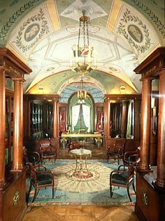ch1- Chateau de la Malmasion Library; Empire style; Large scale; symmetry and geometric forms; Classical details; Tuscan columns; Blues, reds, and golds; Masculine