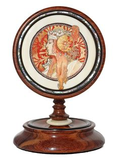 """Deco Lady"" Color scrimshaw on ancient mammoth ivory by Gary Williams. Perfect example of Art Deco motif, bright colors and intricate designs throughout. This is a subject matter seldom seen in contemporary scrimshaw circles. The stand itself is another work of art that mirrors the deco style. Size: 3 3/4"" Diameter x 6""H Price: $2,200.00 -- on ScrimshawGallery.com #scrimshaw"