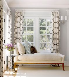 hanging draperies - White and brown lantern print draperies hanging below a window crown molding - Fine Home Building via Atticmag