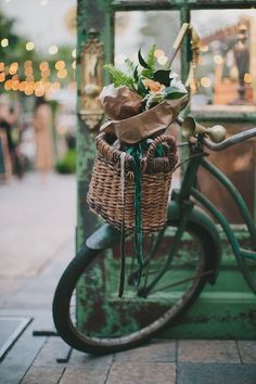 a bicycle basket of flowers