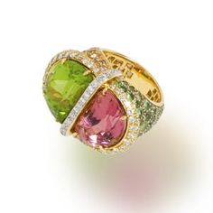 A gem-set and diamond ring by Tony Duquette centering a half-moon peridot and a half-moon pink tourmaline within a round brilliant-cut diamond surround, completed by pavé-set shoulders of circular-cut tsavorite garnet and malaia garnet; unsigned; mounted in 18 kt yellow gold;   Sold at auction for 9,375 USD.