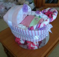 Shalea Designed Pram for Baby Shower, New Baby Gift (Girl)   Contains -  76 New Born Nappies  1 x 000 Winter Jump Suit  2 x Baby Girl Bibs  1 x Large Muslin Wrap  2 x Shoulder Burp Cloths  1 x Baby Wash Cloth  1 x Silver Cake Tray   This Pram is $115.00 and ready to sell.  Prams will be Custom made to Order ... please allow one week pry to Pick up or Delivery   Finished and Wrapped with Cellophane and Ribbon https://www.facebook.com/shaleagiftboxes?ref=hl