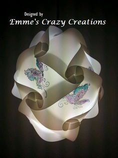 Hanging puzzle lamp with butterfly's. https://www.facebook.com/pages/Emmes-Crazy-Creations/1451836605036302