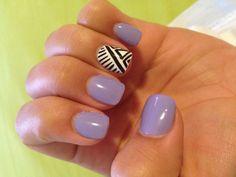 Cute nails! Purple and tribal print! Luv the tribal print craze :)