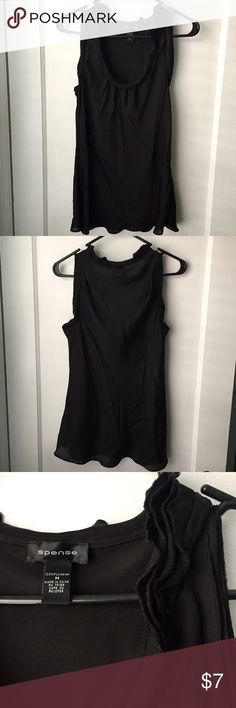 Sheer black tank This silky, sheer black tank is gently used. It's got a slight ruffle around the neckline and makes a great accent under a jacket for the office. The last photo shows how sheer the top is. Spense Tops Blouses