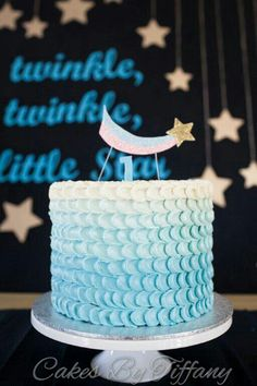 A boys first birthday cake with blue ombre italian meringue buttercream!