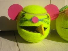 """Strengthen those hands by squeezing a tennis ball with a slit in it... and """"feeding"""" the mouse, or alien, or any little critter you'd like to make.  Fun for OT!"""