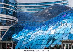 The futuristic glass roof of the Złote Tarasy (Golden Terraces) shopping mall in central Warsaw, Poland. - Stock Photo