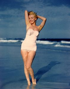 This suit may be old-fashioned but Marilyn's sexy curves are timeless.