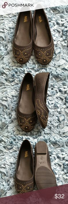 Mia Embellished Flats These cute black flats feature perforated detailing around the shoe with gold stone embellishments on the upper. Synthetic upper with man-made sole. Size  8. MIA Shoes Flats & Loafers