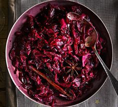 Festive red cabbage Serve this spiced and sticky side dish alongside all the classic Christmas trimmings - it's richly flavoured with red wine, cinnamon, star anise and apples Spiced Red Cabbage, Red Cabbage Recipes, Red Cabbage With Apples, Braised Red Cabbage, Xmas Food, Christmas Cooking, Bbc Good Food Recipes, Cooking Recipes, Ham Recipes