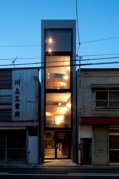 Despite a width of meters and a depth of 11 meters, the compact house' in has managed to reserve, arrange and maximize the space available to evoke a sense of openess. M Width House, Toshima - YUUA Architects and Associates - Japanese Architecture, Interior Architecture, Tokyo Architecture, Tokyo Neighborhoods, Narrow House Designs, House Tokyo, Compact House, Small Buildings, Japanese House