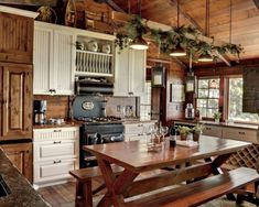 I love that stove!! Would love to have a real wood burning stove like that! Love the drawers, windows, & the ceiling high uppers!