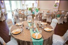 Reception table (linen only)  White table cloth  White chair covers  Silver table overlay  Silver chair how  Yellow table runner  Hints of blue, deep torquise