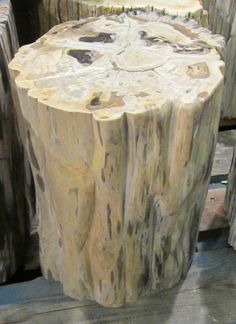 Indonesian petrified wood round cocktail table with ridged side edges. www.balsamoantiques.com