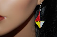 This is a very pretty pair of Native american inspired brick stitch beaded earrings on silver plated surgical steel earwires which are great for those