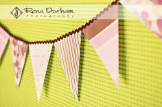 DIY    12″x12″ Scrapbook Paper in a variety of complimentary colors and patterns for the flags  1/2″ Wide Ribbon (length will depend on how long you want your banner to be)  Matching Thread  download my flag template {HERE}  Supplies:  Scissors or a Paper Cutter, Needle (or sewing machine)