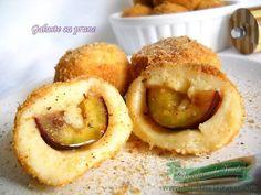 Reteta Gomboti cu Prune cu aluat oparit.Cea mai usoara reteta de Gomboti Gomboti cu fructe.Preparare Gomboti cu Prune sau Galuste cu Prune.