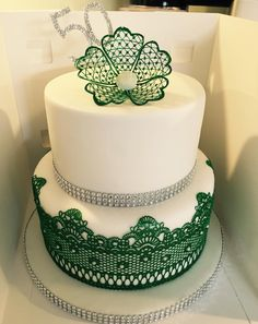 Vanilla & Chocolate 2 Tier 50th Birthday cake with edible green lace & flower.
