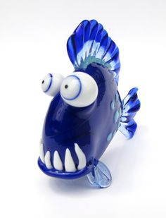 Funny Glass Fish Sculpture. This royal blue voracious glass fish sculpture #1 measures 65mm long by 58mm tall. He's got an appetite!