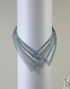 Necklace No. 10443 Light blue silk and medium dark silver. Price: € 63 Other color variations are in the catalo. .......................