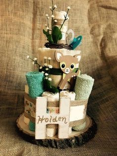 Best 12 A smaller version of the woodland themed diaper cake. Built with over 25 useable, chlorine-free diapers (Seventh Generation SZ Including 4 baby wash cloths, 1 binky & served on a rustic wooden slab. May be customized with babys name as s Baby Shower Decorations For Boys, Baby Shower Themes, Shower Ideas, Baby Shower Diapers, Baby Boy Shower, Diaper Shower, Baby Shower Gifts For Boys, Baby Showers Juegos, Diaper Cake Boy