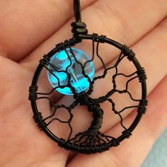 Beautiful glow in the dark full moon Tree Of Life pendant heading out in Friday's mail on its way to a customer!  Available in the Phoenix Fire Designs etsy shop in multiple wire colors! (This one is black wire.)    by phoenixfiredesigns