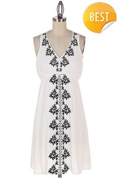 Lovely embroidered mini dress! Fully Lined. White dress features navy stitching and the Navy features white stitching. 100% Rayon Available in White and Navy