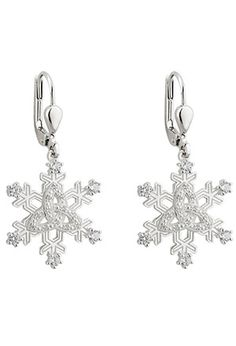 "Start with a sterling silver snowflake. Add a Celtic trinity knot for faith and heritage. Sprinkle with six cubic zirconia crystals for sparkle. And behold! Jewelry you'll love to wear on wintry days and special occasions. A beautiful set from a family-owned jewelry company in the heart of Dublin. Earrings: sterling silver; ⅝""d; 1⅜""l from top of wire, on secure, latching eurowires. Silver hallmarked in Dublin Castle. Gift boxes."