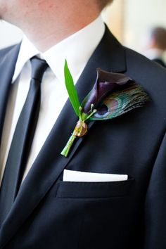 peacock  calla lily boutonniere | ... boutonniere was made with a plum calla lily and a peacock feather