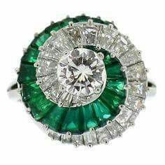 Emerald and diamond spiral ring by Cartier. Set to the centre with a round brilliant cut diamond raised in a four claw setting with a weight of carats, encircled by a swirled row of twenty two channel and claw set tapered baguette cut diamonds. Bijoux Art Deco, Art Deco Jewelry, Fine Jewelry, Jewelry Design, Jewelry Rings, Jewelry Making, Wire Rings, Yoga Jewelry, Cartier Jewelry