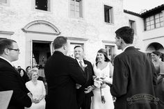The bride and her father meeting the groom at the end of the aisle at Villa Terrace in Milwaukee, by Front Room Photography