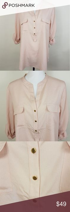 Ivanka Trump Blouse Size XL NWT Ivanka Trump Blouse With 3 Golden Button Detail Front Size: XL Condition: New With Tags Pockets: Yes. 2 chest pockets Zipper: No Neckline: V Neck Material: 100% Polyester Armpit to Armpit: 23 inch From Shoulder to Hem: 27.5 Inch Ivanka Trump Tops Blouses