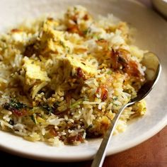 Paneer Biryani Recipe with step by step photos. This is a mildly spiced and delicately flavored dum cooked layered paneer biryani. Paneer Recipes, Veg Recipes, Indian Food Recipes, Cooking Recipes, Ethnic Recipes, Cooking Tips, Paneer Biryani, Dum Biryani, Indian Appetizers