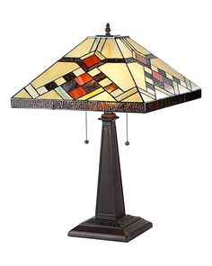 The Arts & Crafts Calhourn Stained Glass Table Lamp, with its colorful intricate and angular design, is a Mission style table lamp that will enhance any decor.