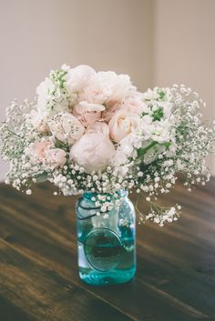 Beautiful bouquet. Peonies, babies breath. My dreams in real life :)   MEGAN AND MATT Photo By Holly Daze Photos