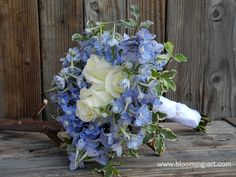 San Diego backyard wedding.  Winter wedding bouquet with blue delphinium and white roses.  San Diego wedding florist, Blooming Art \ blooming-art.com