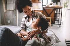 Buy Happy mother playing, having fun, hugging with her son at home by on PhotoDune. Happy african mother playing, having fun, hugging with her son at home Home Exercise Routines, Learning To Let Go, Sonoma County, Adolescence, Happy Mothers, Letting Go, Hug, Sons, Have Fun