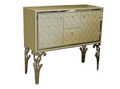 The Hollywood Swank pearl finish sideboard has two center velvet lined drawers with flatware trays, and a velvet lined door at each end with wine storage and a shelf. The Crystal accents make all the difference.