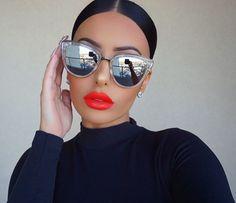 "Bright & Bold  @liplandcosmetics ""Brooklyn"" liquid lipstick #AmrezyCollection  Shades  @whitefoxboutique @quayaustralia  Earrings @queenpee ✨"