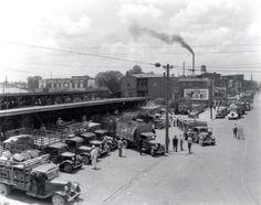 1930s Louisville Kentucky,Haymarket Trucks unloading.