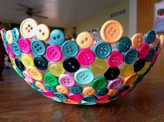 Easy and cute craft idea!  Blow up a balloon and glue buttons to it. Once the glue dries pop the balloon and the buttons should just come off of the balloon. The buttons should be bright so they stand out.